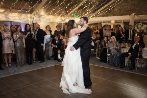 utah wedding couple on dancefloor surrounded by friends and family