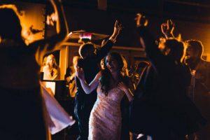 bride and guests dancing on patio at utah lodge