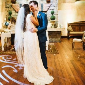 couple dancing in spotlight at a castle wedding