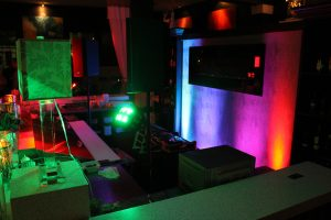 picture of dj setup and lighting on wall with different colors
