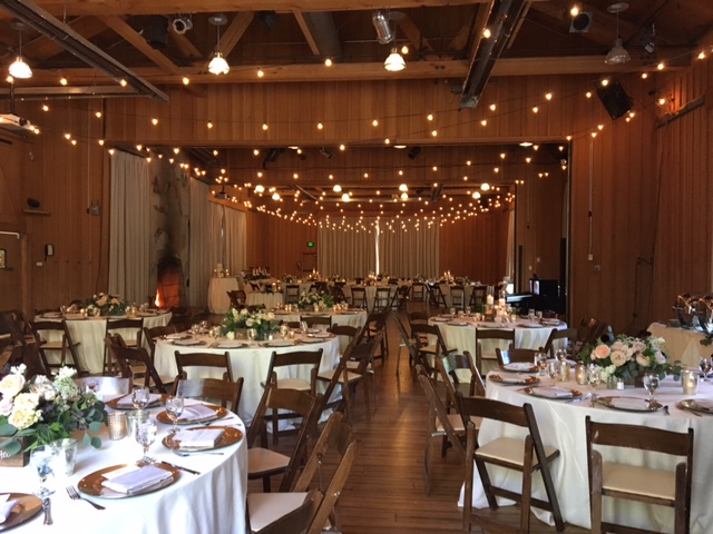 tables and chairs with lights above for utah weddings